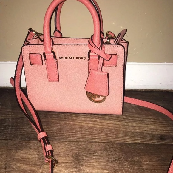 f329446007f5d Michael Kors pink Dillion peach mini crossbody. M 5a9ad916739d48de35660a81